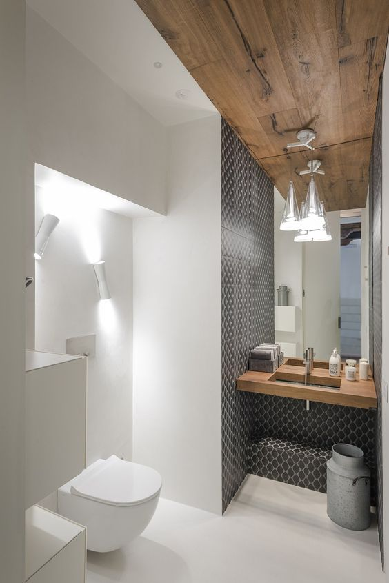09-the-sink-zone-is-accentuated-with-grey-mosaic-tiles-and-the-toilet-zone-is-lit-up.jpg
