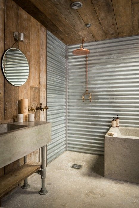 17-corrugated-metal-sheets-and-concrete-floors-for-a-rough-industrial-bathroom.jpg